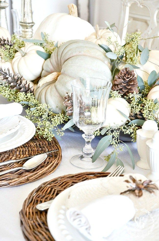 NEUTRAL AND NATURAL THANKSGIVING TABLE- A beautiful table filled with white and blue pumpkins, seeded eucalyptus, pinecones and more! Get inspired!