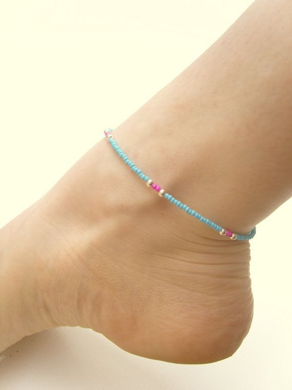 "Seed Bead Anklet Pink and Blue Beaded Anklet by JewelleryByJora A dainty beaded ankle bracelet made with blue seed beads featuring pops of hot pink & silver plated beads and lobster clasp. Measures 9.75"" long (25cm) -medium."