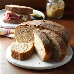 Caraway Seed Rye Bread Recipe -My parents were emigrants from Czechoslovakia and my mother would bake this bread when guests came over for dinner. Today, every time I bake it, I get nostalgic for those days. —Millie Feather, Baroda, Michigan