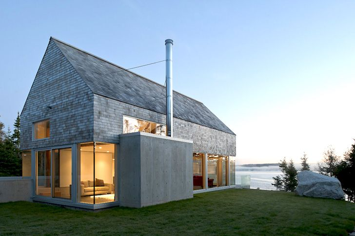 Passive solar Martin-Lancaster House is wrapped in glass and c...