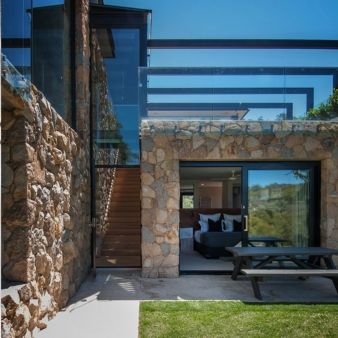 A glass balustrade runs above the bedroom, seemingly connected to the sky above