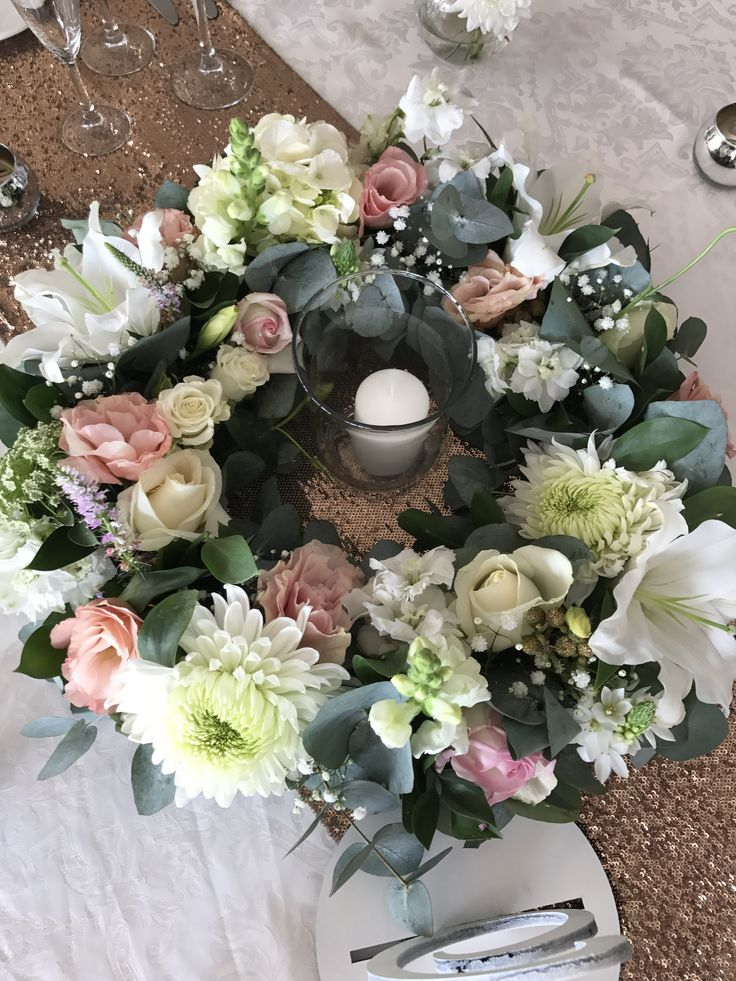 Beautiful white & blush wreath centerpiece perfect for your wedding. Designed by Bliss Floral Creations