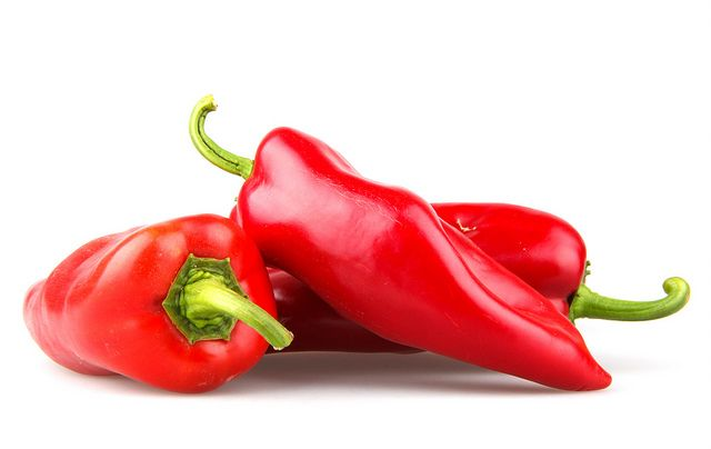 Red chilli peppers on white background. Just Amazing http://dld.bz/anaboliccooking