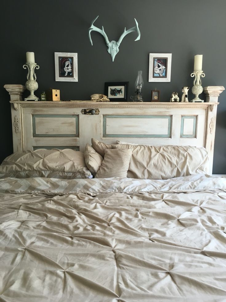 Reclaimed French Provincial / shabby chic antique door headboard made by my husband using vintage hardware, trim, dark wax, and chalk paint.
