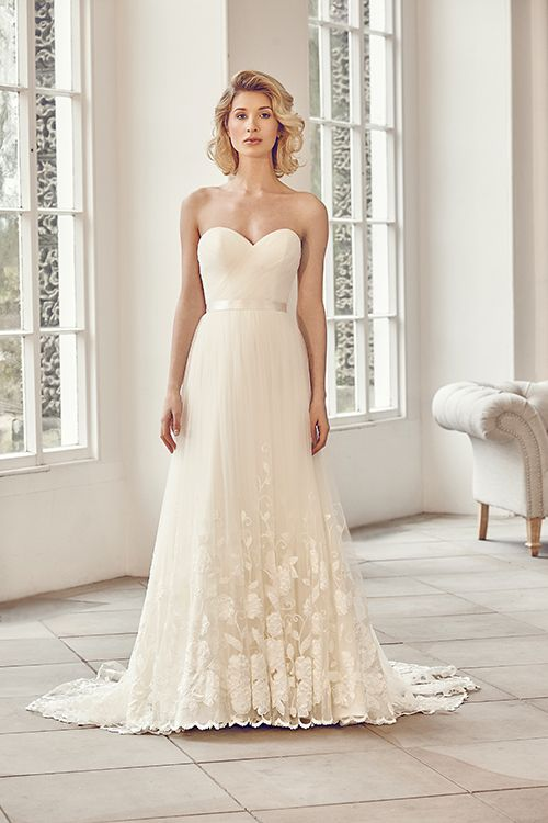 A strapless princess gown that features bespoke corded lace and tulle.  <strong>Size: </strong>8 – 30 <strong>Colour: </strong>Ivory / Ivory <strong>Fabric: </strong>Bespoke Corded Lace, Tulle <strong>Style: </strong>Princess <strong>Neckline:</strong> Strapless / Sweetheart <strong>Laced or Zipped: </strong>Zipped