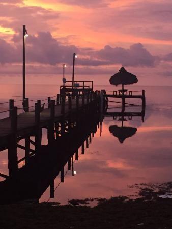 Beautiful view of the sunrise over the pier, Seashell Beach Resort  |  57612 Overseas Highway, M