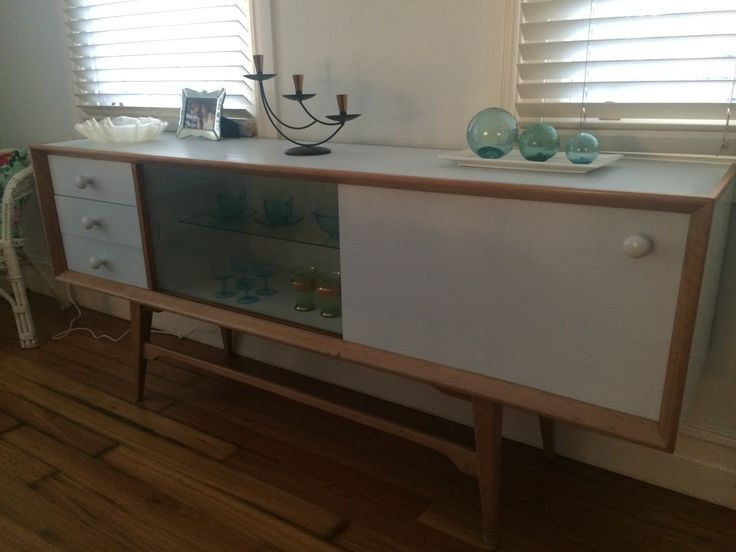 Mid-century buffet restored to new life. Painted in soft blue-grey, timber waxed. LED lights installed in glass section to illuminate contents. Can be set on any colour. For sale at $1,200