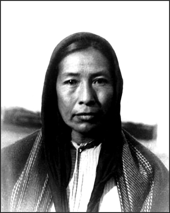 """Quapaw woman, Mihita or Low Sun. Photo: 1894. - The Quapaw (Ugahxpa in their own language) are believed to have migrated from the Ohio River valley after 1200 CE as a result of wars with invading Iroquois from the north. They moved to their historical territory, the area of the confluence of the Arkansas and Mississippi rivers, by the mid-17th century. The state of Arkansas was named after the Quapaw, who were called Akansea or Akansa, """"land of the downriver people"""", by other Native Tribes."""