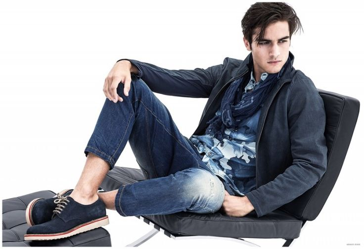 Model Aleksandar Rusic takes it easy in slim distressed jeans and a blue printed shirt from Armani Jeans.