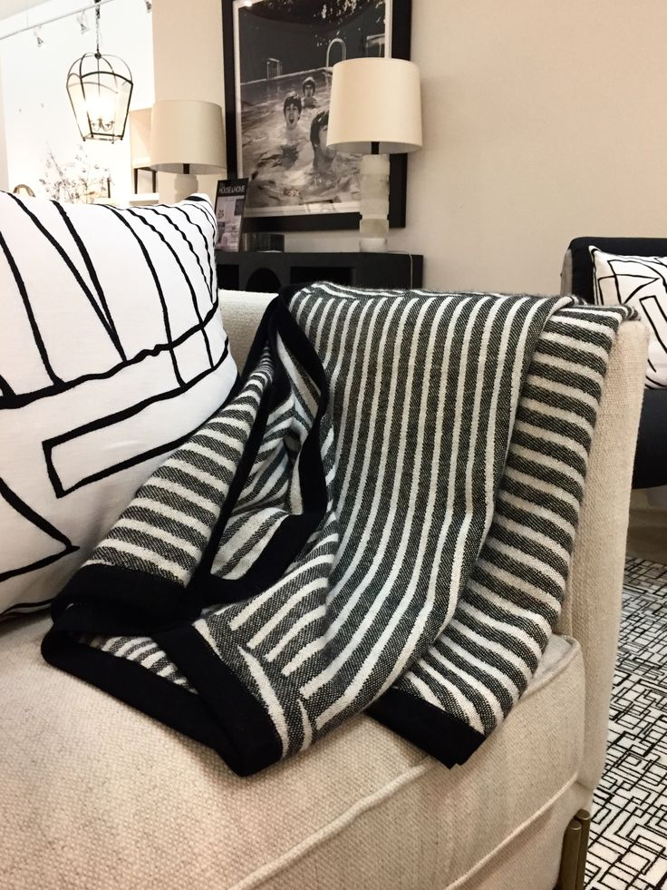 Kelly Wearstler throw and cushion at Cocoon Furnishings. #kellywearstler #insidecocoonfurnishings #cocoonshowroom