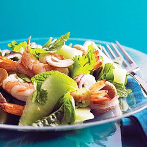 The melon cools the spice in this fresh, lively summer salad. We like it with shrimp, but it's also good with grilled calamari.