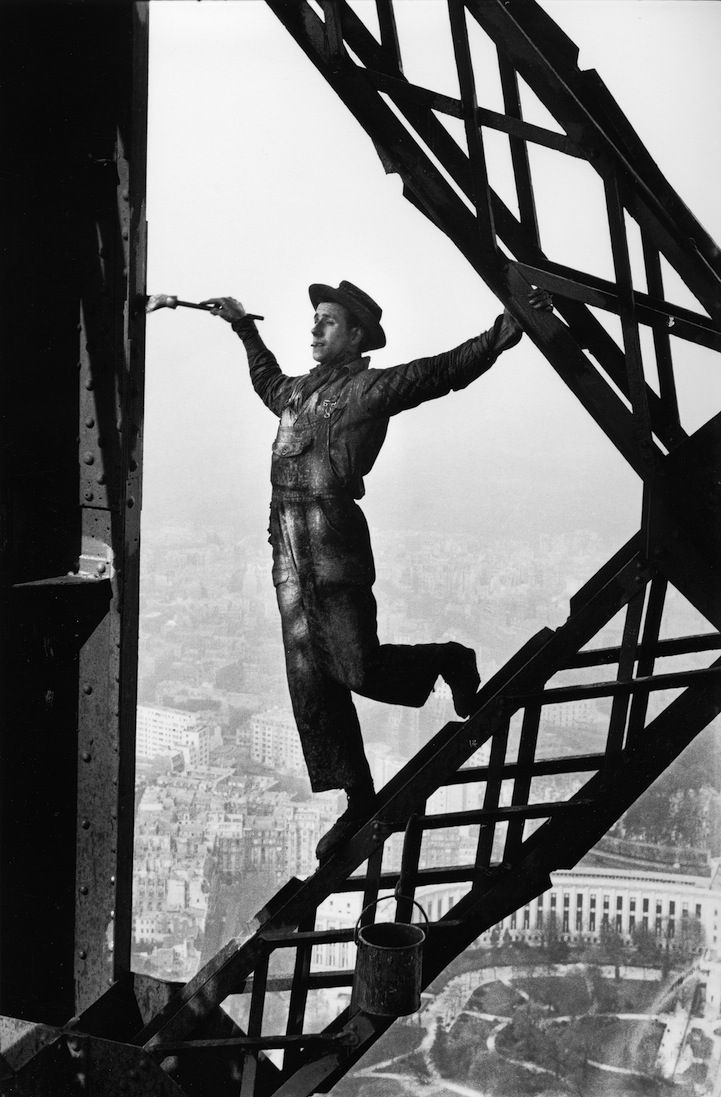 I just love this photo - it inspires in some magical way!   The painter of the Eiffel Tower, 1953  Photo: Marc Riboud