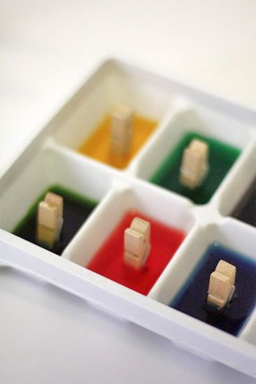 Paint with Ice.  Add food coloring and clothes pins before making ice in trays.  Once frozen, kids can use them as the 'melt' on paper...