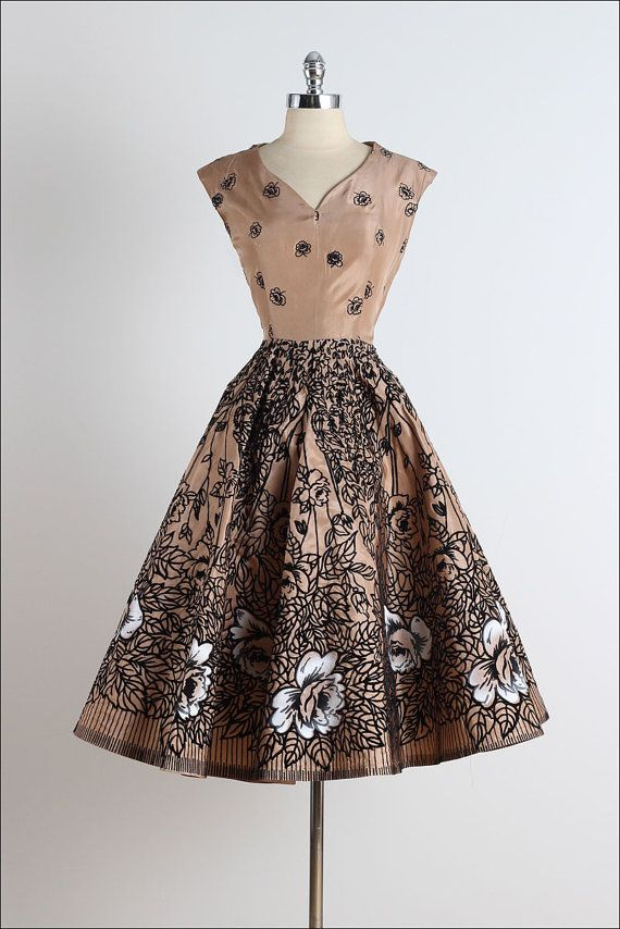 ➳ vintage 1950s dress    * mocha acetate  * black flocked flower print  * white airbrushed flowers  * metal side zipper    condition | excellent    fits like medium    length 45  bodice 15  bust 38  waist 28  bodice allowance 1    some clothes may be clipped on dress form to show best fit for appropriate size.    ➳ shop  http://www.etsy.com/shop/millstreetvintage?ref=si_shop    ➳ shop policies  http://www.etsy.com/shop/millstreetvintage/policy    twitter | MillStVintage  facebook…