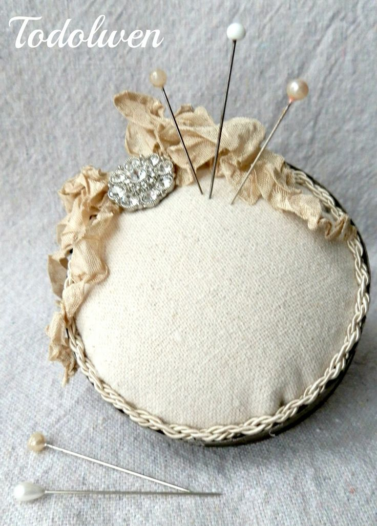 A pincushion  creation made from an old cookie cutter