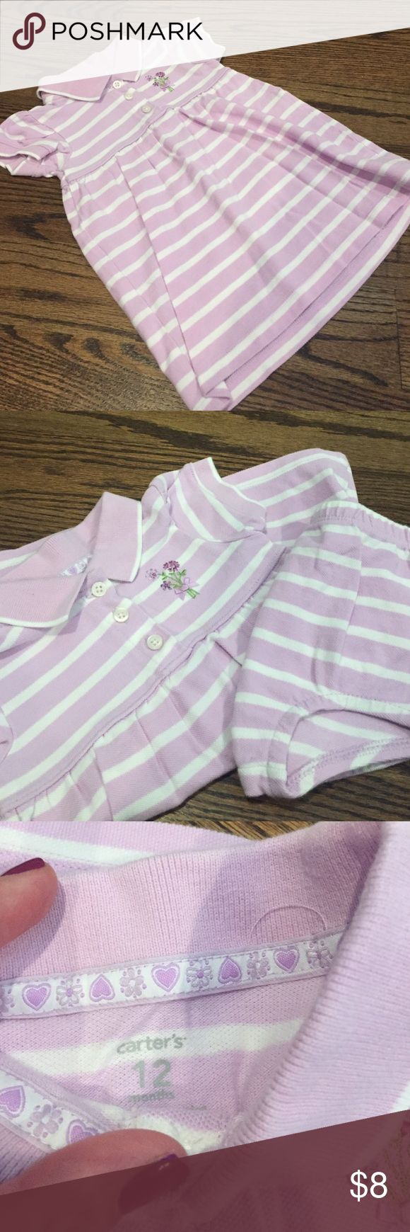 🎀New listing🎀Purple striped Carters dress This purple & white striped dress from Carters has the look of a pique polo with a touch of feminine.  There is floral detail with a bow on the left front.  Includes matching bloomers.  In very good used condition.  Size 12 months. Carter's Dresses