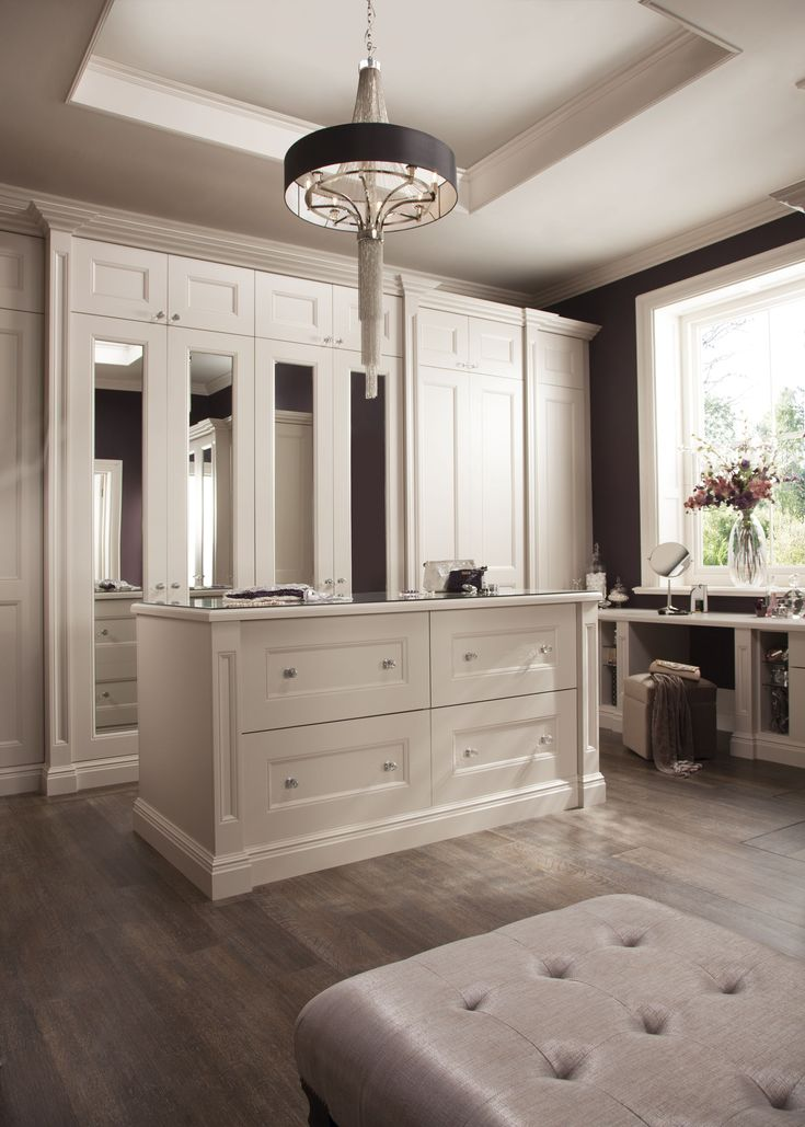neville johnson luxury dressing room with fitted wardrobes integrated shoe storage and adjustable drawer