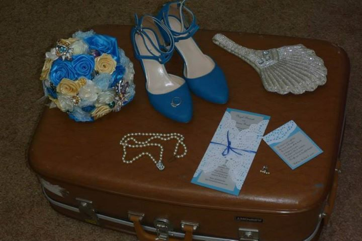 Shoes, jewellery, bag, wedding invites and DIY ribbon bouquet laid out