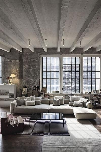 White ceiling, loft, grey brick, dark floor + exposed beams woods stain
