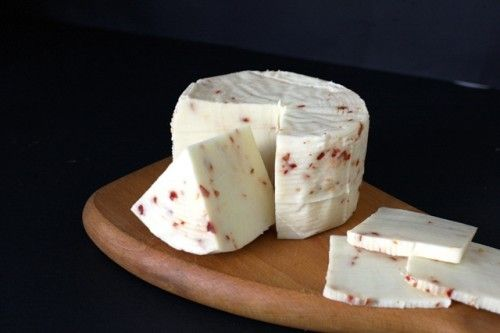 Fresh Pecorino Cheese with red pepper  Fresh and soft chesse , made with only milk from sheep and goats . Compact and  wrinkled rind dark yellow , with characteristic aroma  #sicilian #cheese #pecorino #fromages #siciliens #formaggi #siciliani #piment #chili #peperoncino