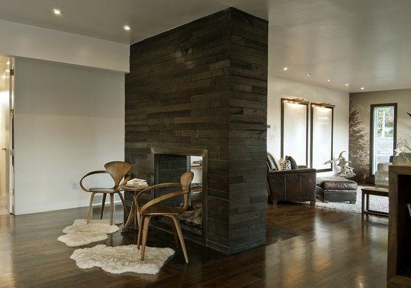 schönes wohnzimmer mit einer massiven trennwand - moderne gestaltung