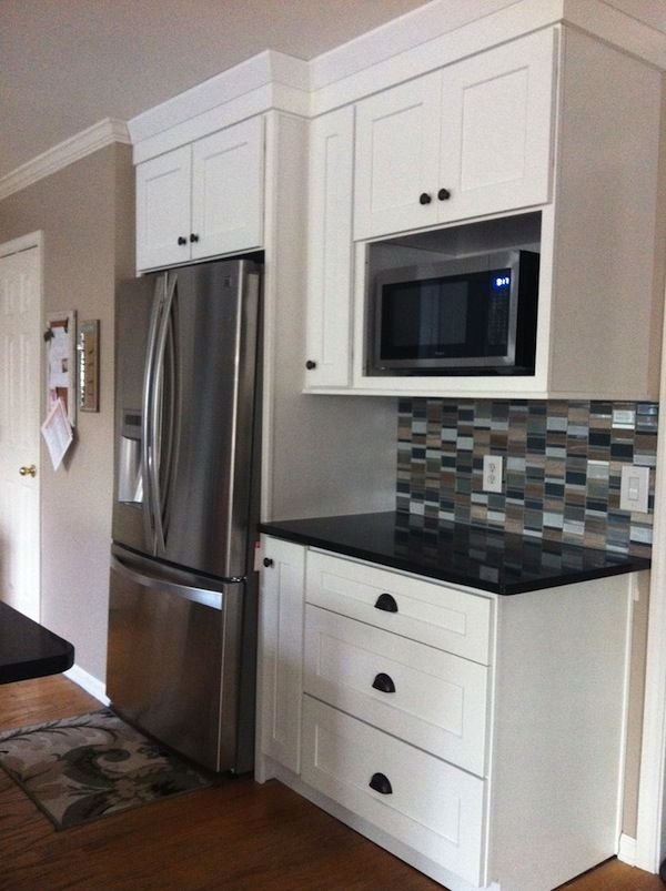 microwave shelf, dark quartz with white cabinets, stainless appliances