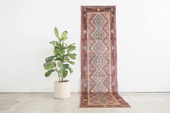 name: Jannat style: hand knotted, Persian, Koliai, rug, runner, carpet material: wool colors: pink, yellow, light blue, green, indigo, brown, gray, black, cream, burgundy age: vintage condition: good, age related wear 33 x 113 (closest standard rug size is 3x9.5)  Please see pictures for detailed condition. There are more photos of this product available on our website HomesteadSeattle.com  We ship nationwide. Please contact us if youd like a more exact or combined shipping quote.