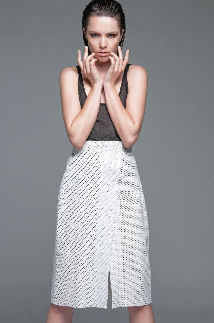 So stylish & chic Anna Veneti white leather perforated skirt with frontal split!