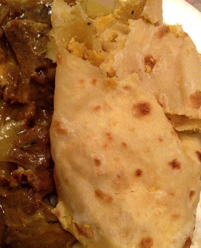 Roti is a type of bread popular in South Asia as well as the Caribbean. Similar in appearance to a Mexican tortilla, it is made with wheat flour and no leavening. In Jamaica roti is often eaten with a filling of curry goat or curry chicken.