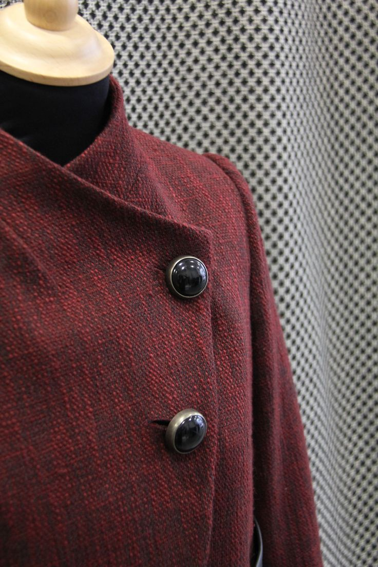 jacket detail. Warm red and black