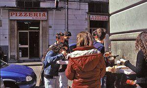 People eating pizz outside L'Antica Pizzeria da Michele, Naples.