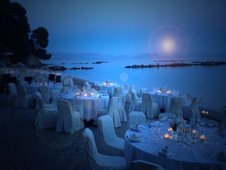Blue moon beach wedding | Corfu  Keyhole View: Tables up to the waves