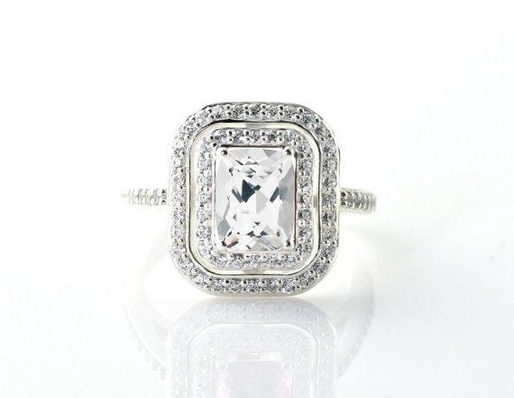 Emerald-Cut #Diamond E-Ring with Double Halo (Credits: photo from RareEarth [etsy])
