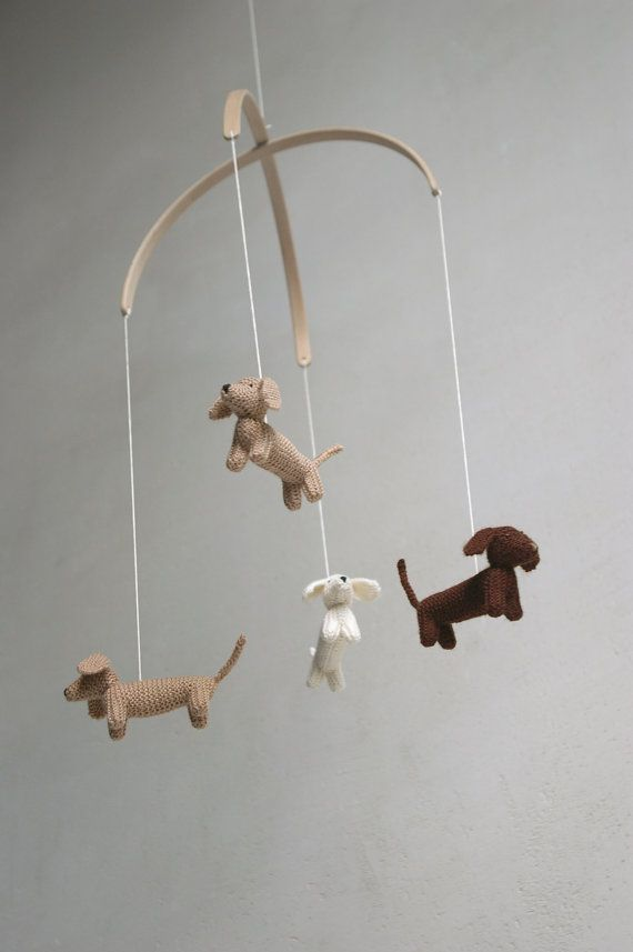 These lovely knitted jumping dachshunds mobile will bring joy to your babys nursery. I knitted these dachshunds from soft baby wool (mixed yarn - wool, bamboo, acrylic). They are filled with natural white undied wool. Dogs hang on beech tree half circle details (10 in diameter). You can order dachshunds in other color (all in white). Mobile is prepared to hang from the ceiling. Long string (~3 meters) and special hook are included. Lenght of mobile is ~50 cm or 20 in.  size of dachshund is…