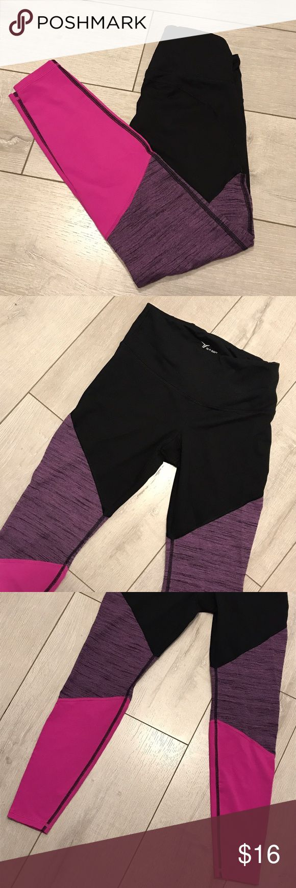 Old Navy leggings Old Navy Go-Dry high-rise color-block leggings in black, purple, and pink. Size Medium Petite. Only worn twice - like new! Body is 85% polyester and 15% spandex. Would make a super cute addition to your workout wardrobe! Old Navy Pants Leggings