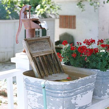 Sounds of the Country: Fountain made from an old red pump, washboard and laundry tub. Fun!