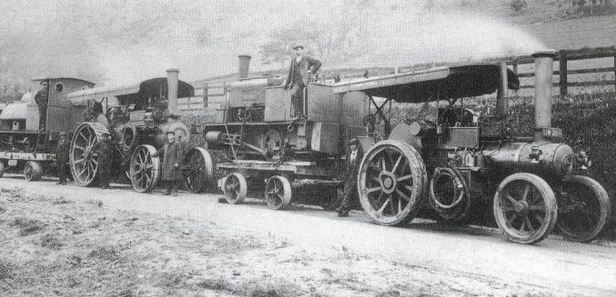wynns: 2 x Fowler engines belonging to well known Welsh company Wynns, seen here around 1920 loaded with narrow gauge locos destined for one of the slate quarries. (Personal-Album-349-Image-47856)
