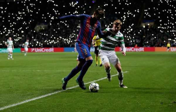 Gerard Pique of Barcelona vies with Stuart Armstrong of Celtic during the UEFA Champions League match between Celtic FC and FC Barcelona at Celtic Park Stadium on November 23, 2016 in Glasgow, Scotland.