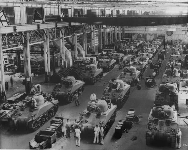M4 Sherman tanks being built at the Detroit Arsenal Tank Plant Warren Michigan United States 1940s.