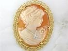 A crowd favorite has been added to our estate collection!  This gorgeous brooch features a beautiful victorian woman's profile accented by an inset diamond on her pendant!  Each detail of her voluminous hair and her beautiful face is hand engraved! Yellow gold is the best setting for such a beauty, and we have placed it at a wonderful price!     If vintage and antique jewelery is your cup of tea, we're brewing every day!    $500