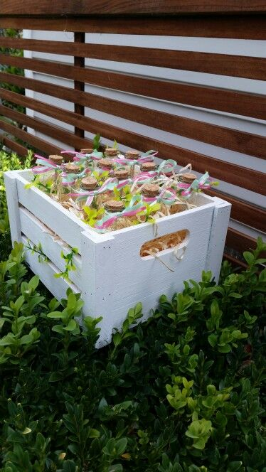 Party favors sitting in a white wooden crate.