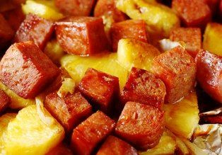 BAKED PINEAPPLE SPAM  ==  1 can Spam, cubed 1/4 cup Aloha shoyu Ginger, grated 1/4 cup Brown sugar 2 tablespoons water fresh or canned pineapple, cubed  ==========