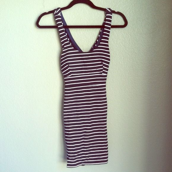 Navy blue and white striped dress Cute going out dress. Worn once.  Size Medium. Kriss-kross back! Dresses