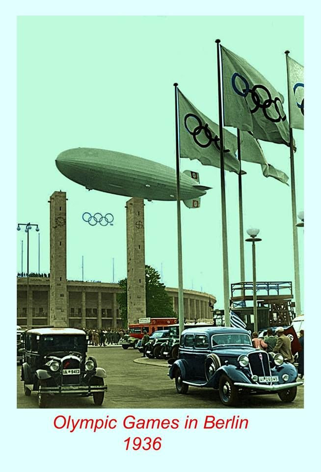 "The mighty (and ill-fated) Zeppelin, the ""Hindenburg"", flies over the Olympiastadion in Berlin as part of the processions for the 1936 Summer Olympics."
