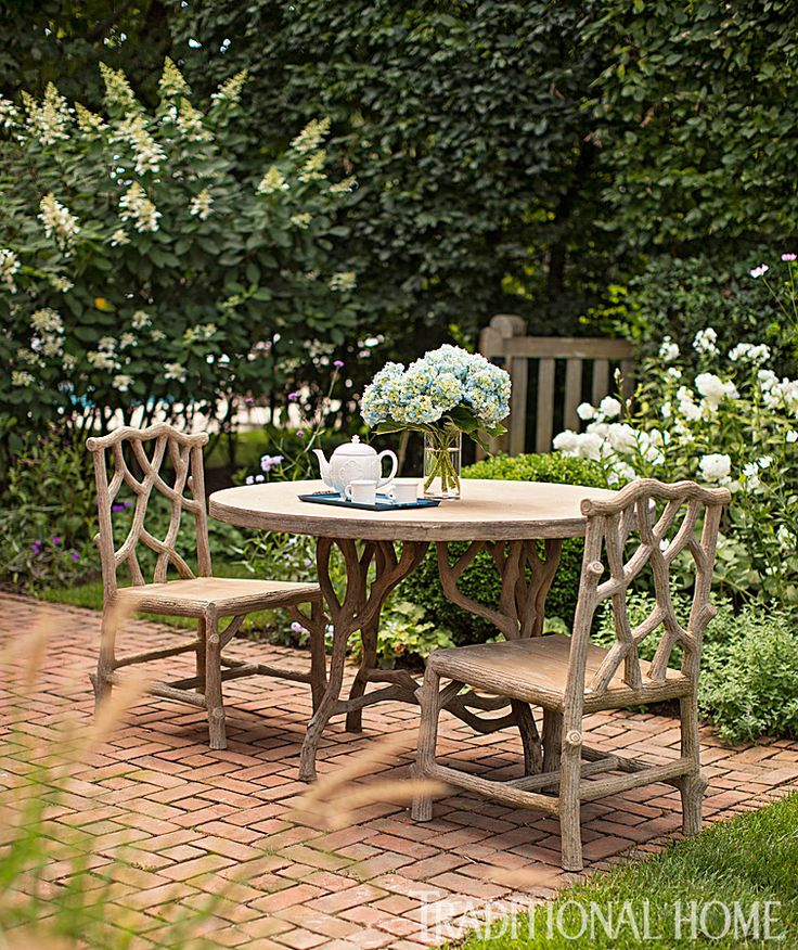 A Faux Bois Table And Chairs Sit On An Intimate Bedroom Patio.