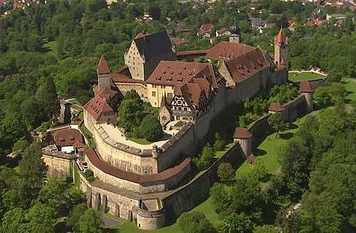 """The Veste Coburg, or Coburg fortress, above the city of Coburg, Bavaria, Germany... www.castlesandmanorhouses.com ... Veste Coburg (also called the """"Franconian Crown"""") is one of Germany's largest castles. It dominates the town of Coburg on Bavaria's border with Thuringia. It was the historical seat of the independent duchy of Coburg in Franconia, now part of the German state of Bavaria."""