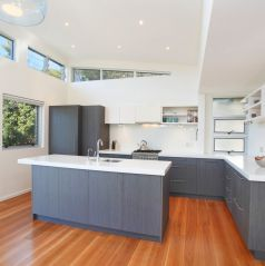 corian benches, ilve gas appliances, timber floors, grey cabinets, plenty of natural light, architecture