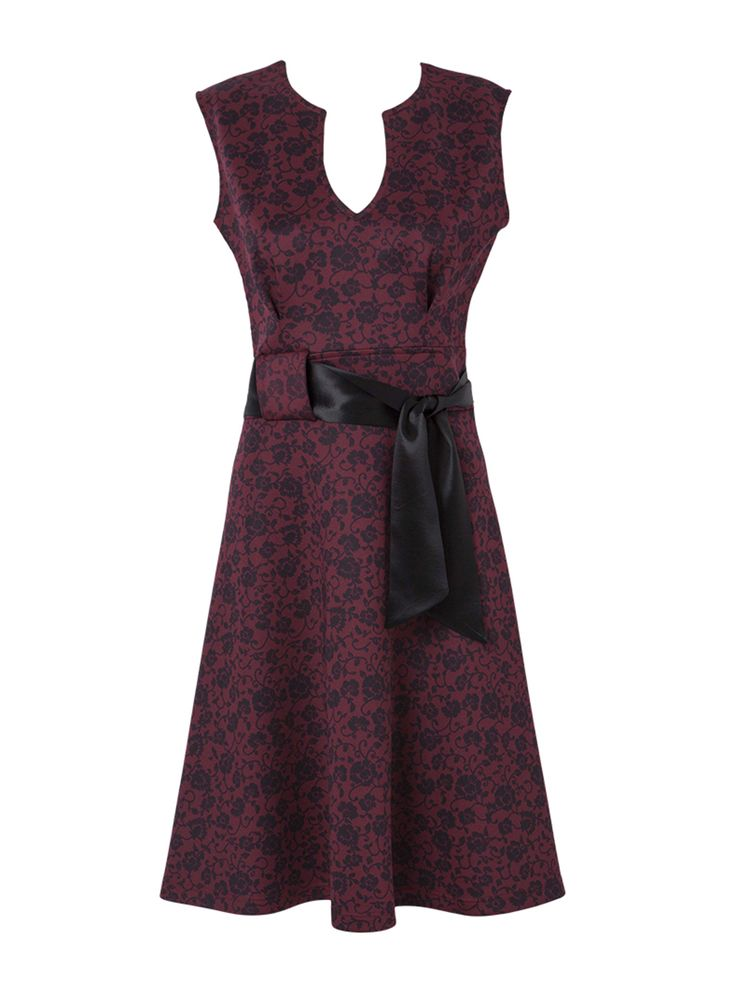 Floral print dress with silk belt.