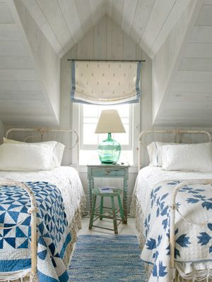 Loosen up a traditional bedroom with mismatched quilts.
