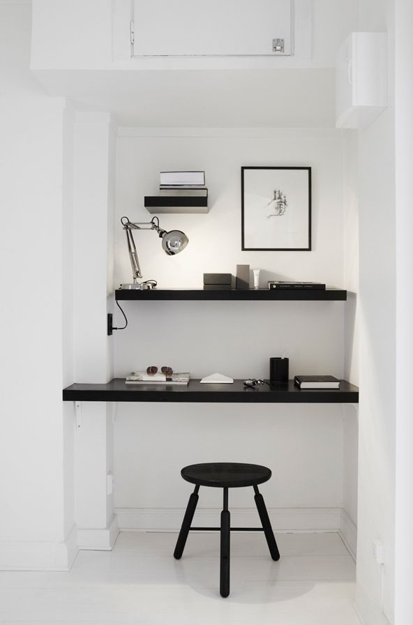 Love the floating shelves, and the black makes everything pop! Would love a space like this with a better chair and much more space, but love the shelves and the color contrast.